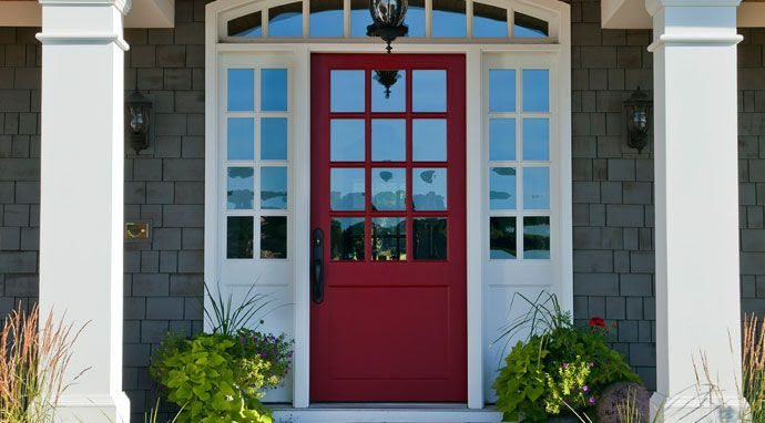 Benjamin Moore's pomegranate color on the door -- great combo with the gray and white house colors