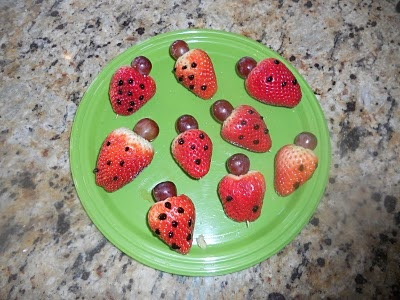Ll is for Strawberry Ladybugs. Cut strawberries in half. Stick toothpick through a blueberry or grape for the head and the strawberry. Add chocolate dots of different numbers to practice counting too!