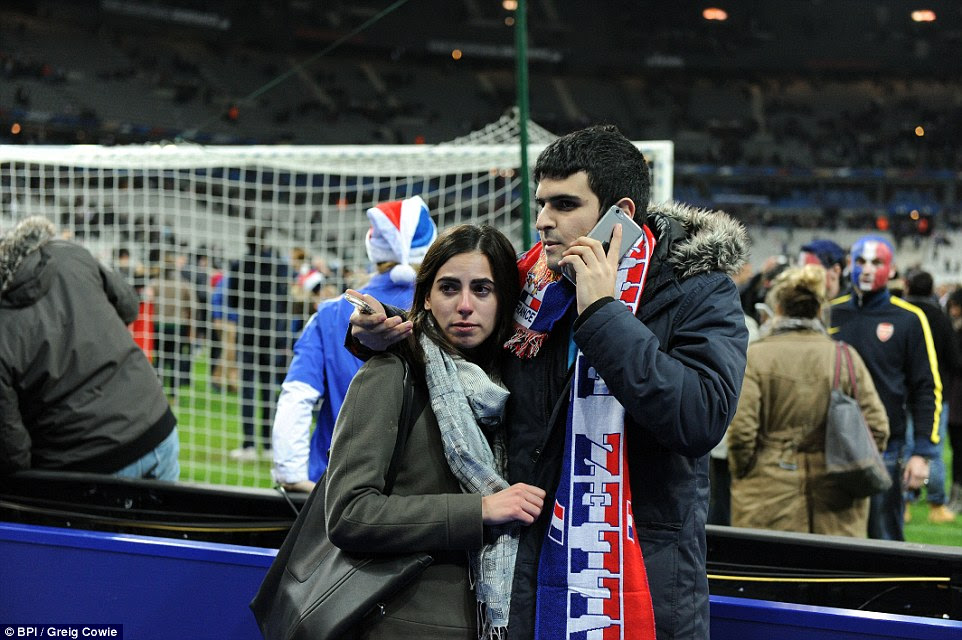 http://i.dailymail.co.uk/i/pix/2015/11/14/00/2E6CBCDB00000578-3317836-A_French_couple_stand_together_inside_the_Stade_de_France_after_-a-61_1447459227212.jpg
