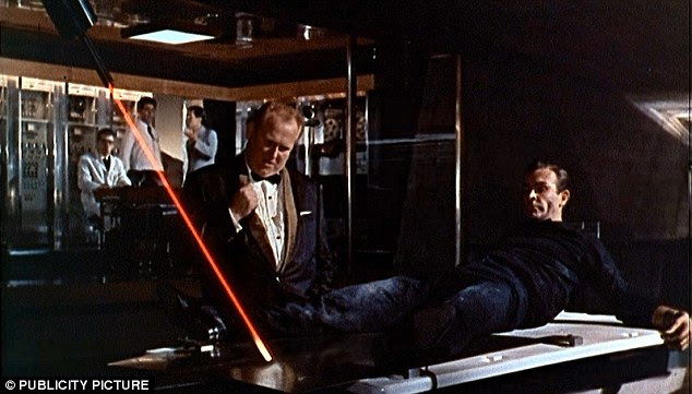 The laser watch was inspired by 1964 Bond film Goldfinger. In this scene, Auric Goldfinger (played by Gert Fröbe) ties James Bond (Sean Connery) to a table and threatens to cut him using the laser pointer (pictured)