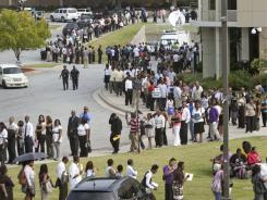People wait in line during a job fair in August at Atlanta Technical College in Atlanta. The weak economy has driven median household income down, hitting poor people and minorities the hardest. The median income for black households fell 3.6% to $32,206 last year.