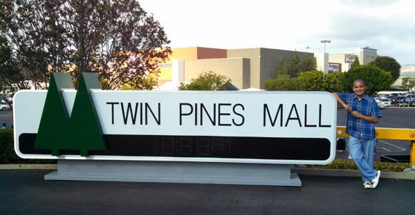 Posing with the Twin Pines Mall sign from BACK TO THE FUTURE at Puente Hills Mall in the City of Industry...on October 18, 2015.