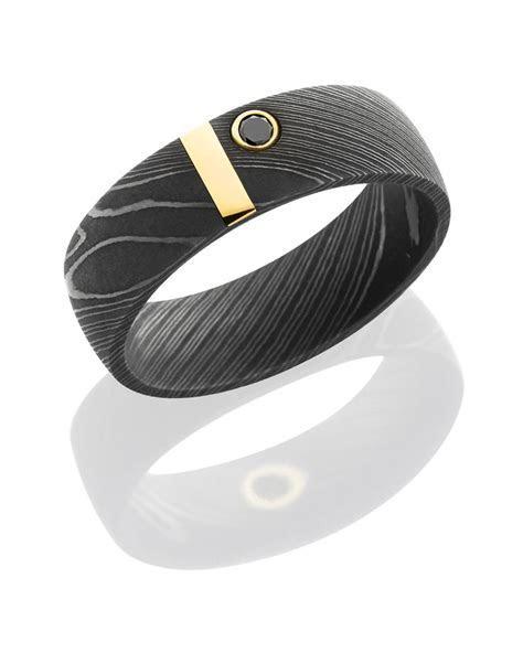 Damascus Ring with 14K gold bar and black diamond.   Award