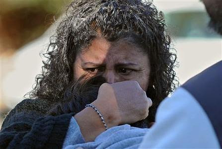 A woman holds her son after picking him up at following a school shooting in Sparks, Nevada, October 21, 2013. REUTERS-Andy Barron-Reno Gazette-Journal