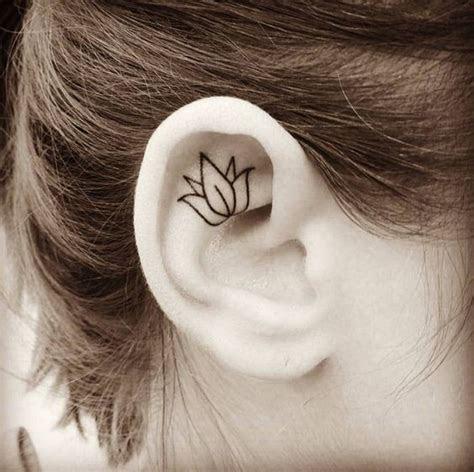 lotus outline helix ear tattoos