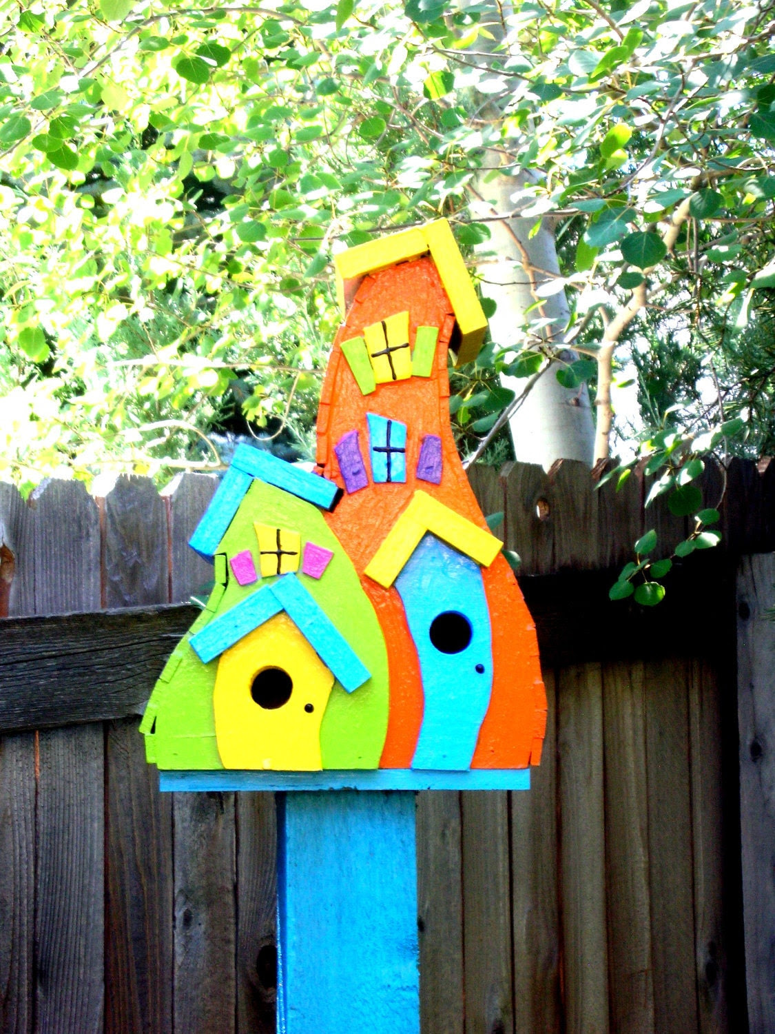 Homemade birdhouse bright colors