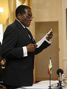 Comrade President Robert Mugabe swearing in 25 ministers of state and deputies for the inclusive government in the Republic of Zimbabwe. by Pan-African News Wire File Photos