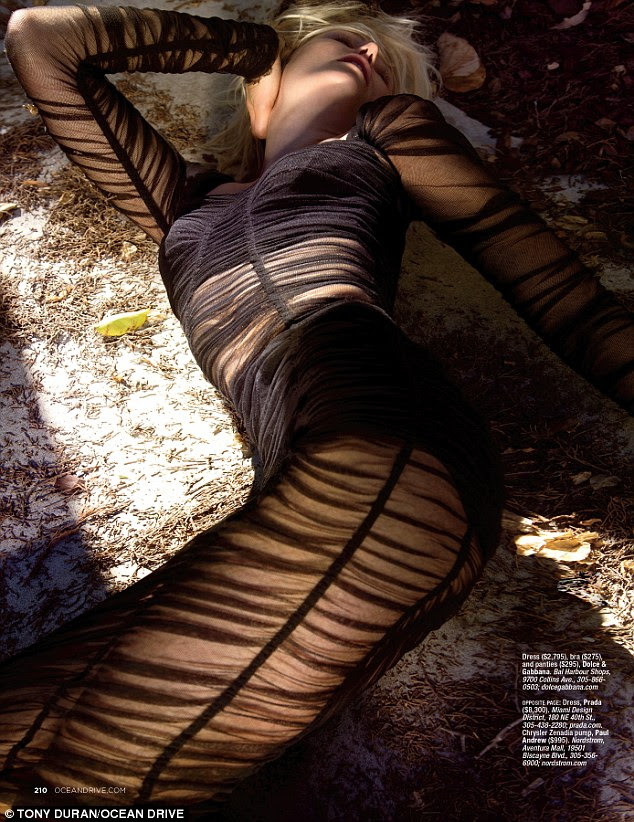 Showing off her assets: Malin Akerman writhed on a carpet in a sheer black dress, showing off her bra and panties, all by Dolce & Gabbana, in a cover shot for the March issue of Ocean Drive