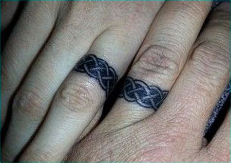 30 Awesome Loving Ring Tattoo Designs   Awesome Loving