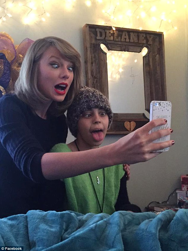 The duo posed for a number of selfies pulling silly faces.'Literally speechless right now!!!!! My new best friend ( as I call her now ) made a special stop from going home to Tennessee and surprised me,' Delaney captioned an image of herself with Taylor
