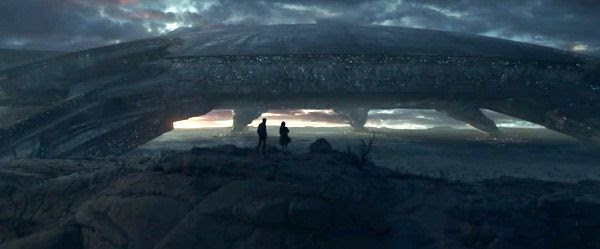 Two humans gaze at an alien structure on Earth in INDEPENDENCE DAY: RESURGENCE.