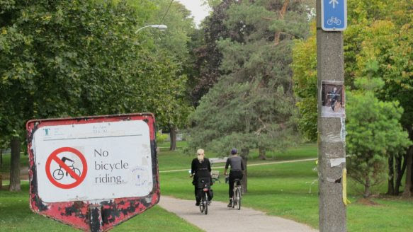 Signs along a recreational path that cuts through Riverdale Park West, just outside the Riverdale Zoo, offer contradictory advice that is confusing to cyclists and even pedestrians.