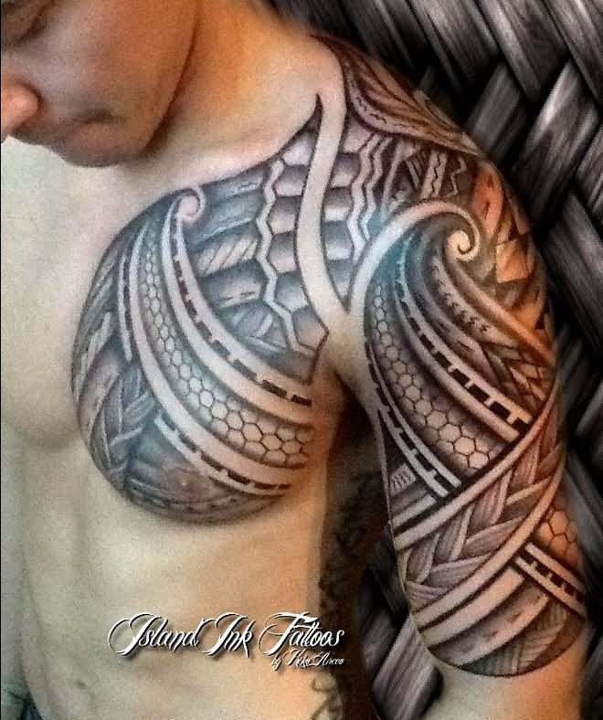 Man Chest And Left Half Sleeve Tribal Tattoo