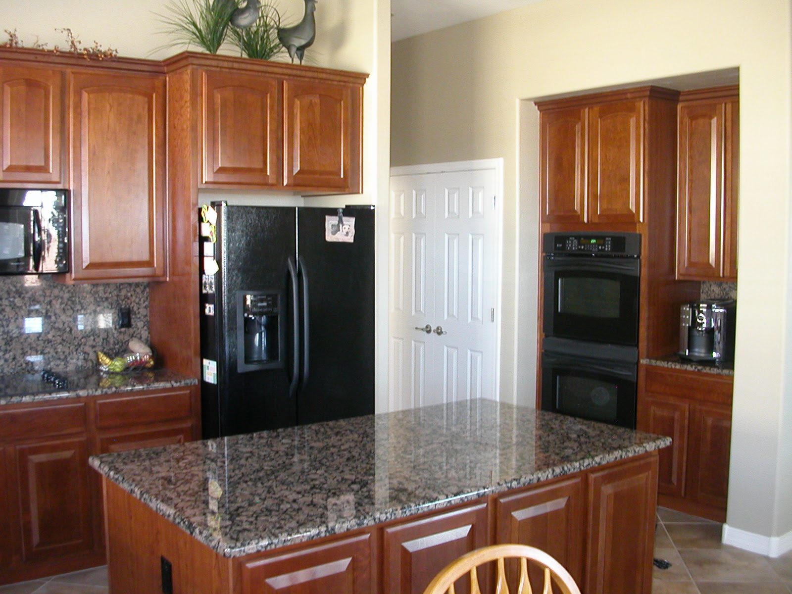 Kitchen with Black Appliances and Stainless Steel