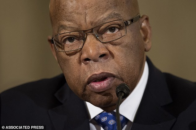 In this Jan. 11, 2017 file photo, Rep John Lewis, testifies on Capitol Hill in Washington at the confirmation hearing for Attorney General-designate, Sen. Jeff Sessions, before saying he does not consider Donald Trump to be a legitimate President