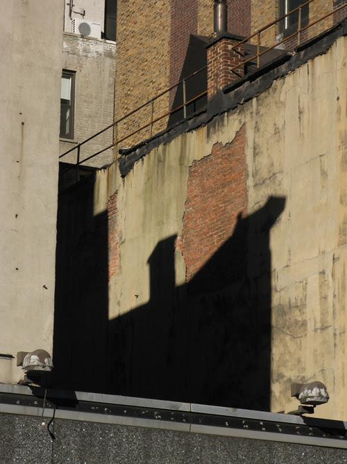 shadow on a 34th Street building, Manhattan, NYC