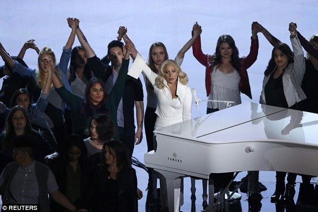 Meaningful:Dozens of victims of sexual abuse appeared on stage holding hands behind her as she performed at the piano on stage