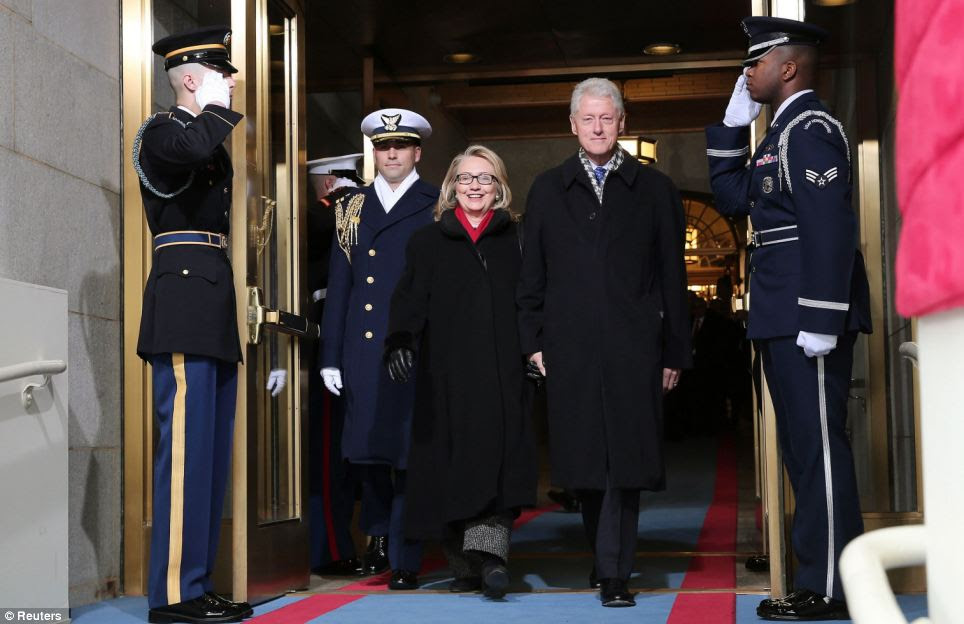Arrival: Secretary of State Hillary Clinton is joined by her husband, former President Bill Clinton, as she arrives at the inauguration
