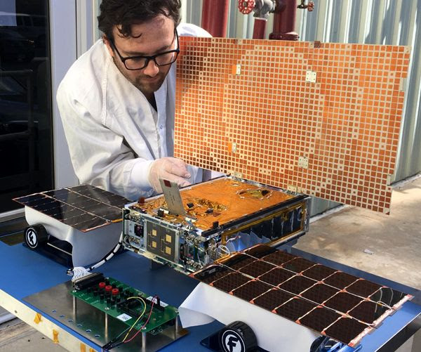 NASA engineer Joel Steinkraus uses sunlight to test the solar arrays on one of the MarCO spacecraft at the Jet Propulsion Laboratory in Southern California.