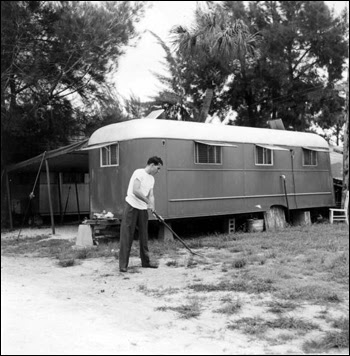 Al Stickles tends to the area near his trailer: Sarasota, Florida (1946)