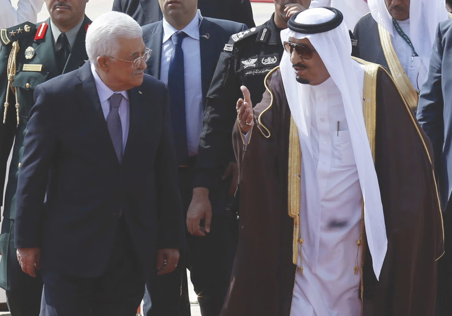 Saudi Arabia's King Salman bin Abdulaziz Al Saud walks with Palestinian President Mahmoud Abbas