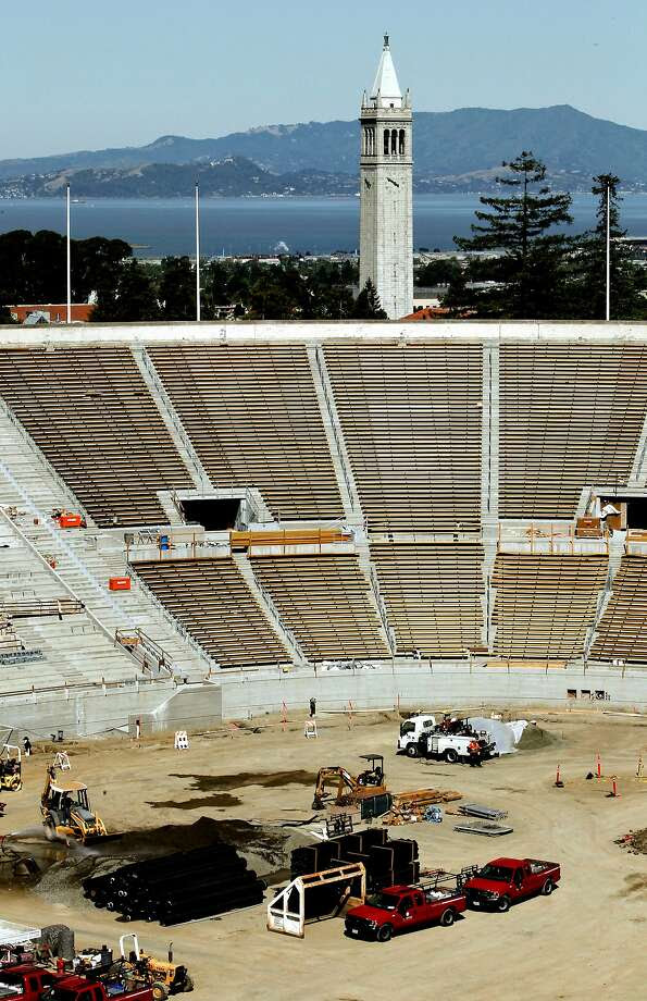 Construction crews were putting the finishing touches on the seismic retrofitting and renova tion of UC Berkeley's Memorial Stadium in 2012. The stadium today carries a $314 million debt. Photo: Michael Macor, The Chronicle