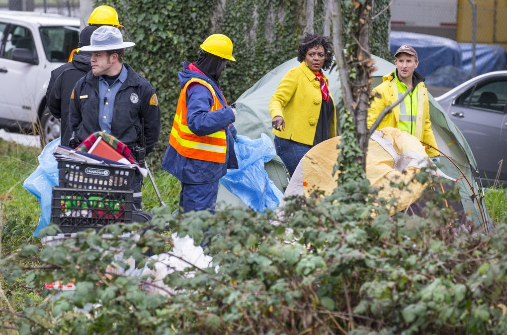 City, county and state teams assess the health and safety conditions of homeless people living in encampments under and near the Interstate 5 and Interstate 90 interchange in South Seattle on Thursday. (Mike Siegel/The Seattle Times)