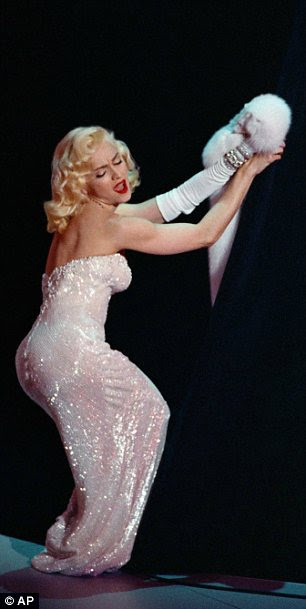 Madonna, who has famously appropriated Monroe's look into her image, performing in 1991