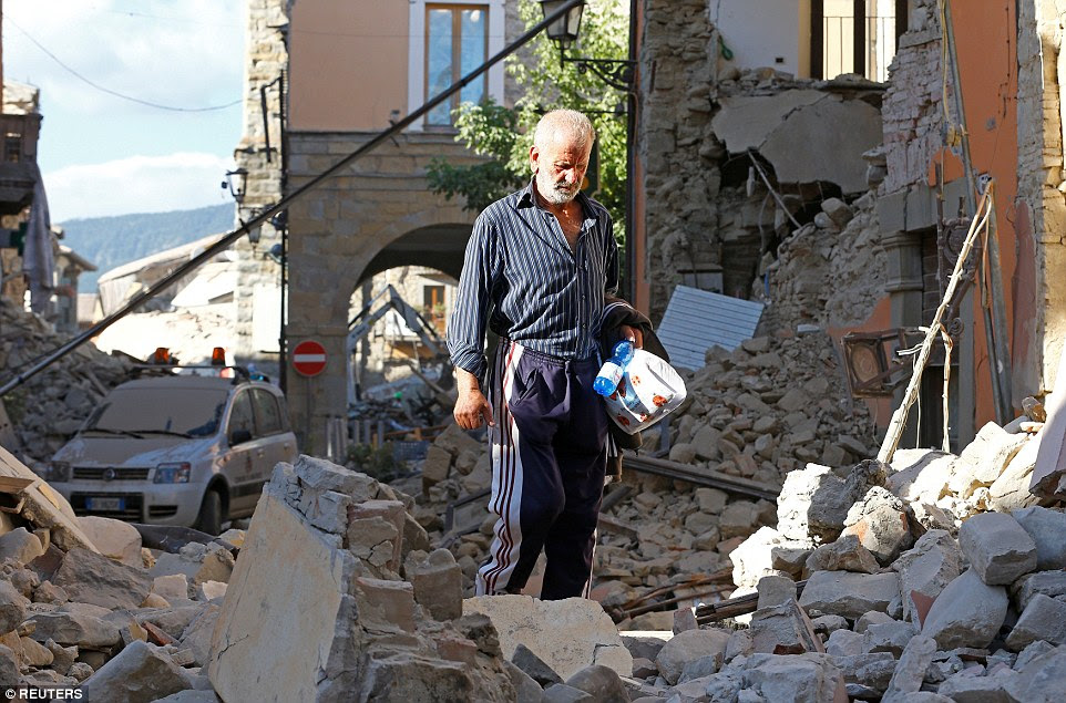 A man walks through the rubble in the devastated town of Amatrice. Wednesday's disaster is the biggest in the region since April 2009