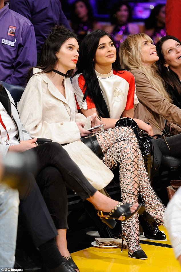 Fancy footwear:Kendall made sure people took their eye off the ball wearing just an oversized linen jacket and a pair ofSophia Webster white and black lace up high heel boots