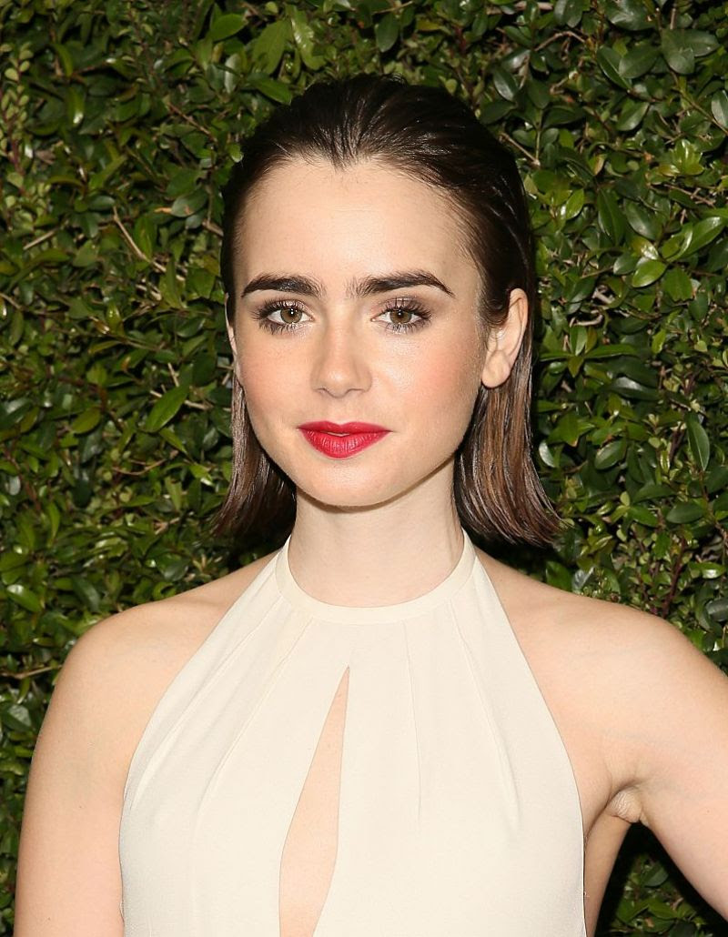 LILY COLLINS at Chanel and Charles Finch Pre-oscar Dinner in Los Angeles