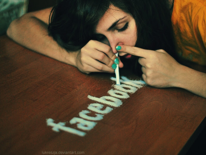 A girl inhaling the facebook banner written in a drug like substance.