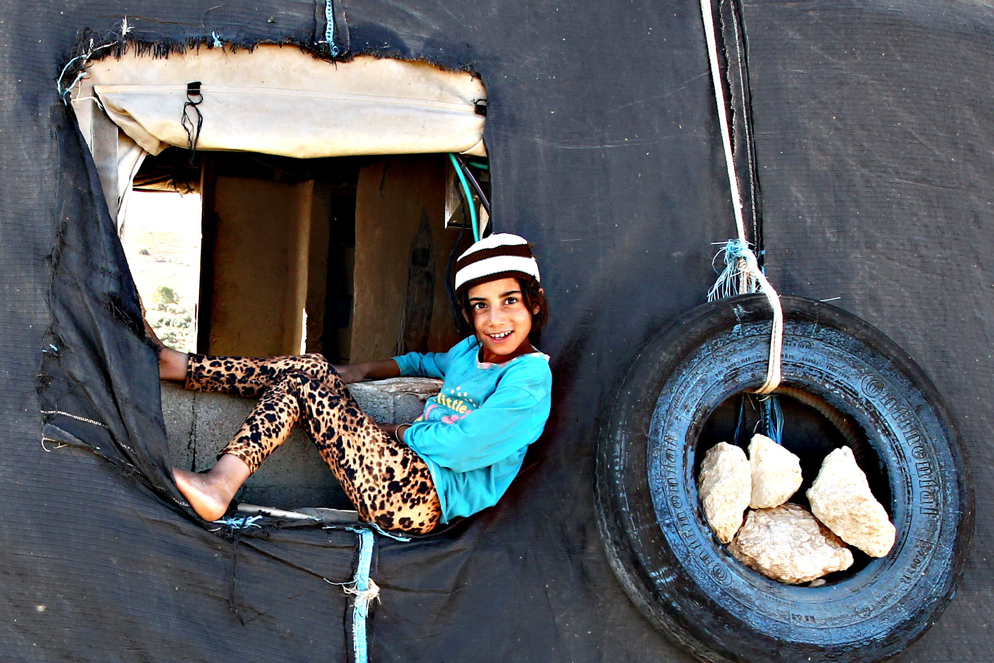 A Palestinian girl plays outside a tent in the southern West Bank village of Susya on Wednesday. Israel's High Court ruled in May that Susya's 340 residents could be relocated and its structures demolished
