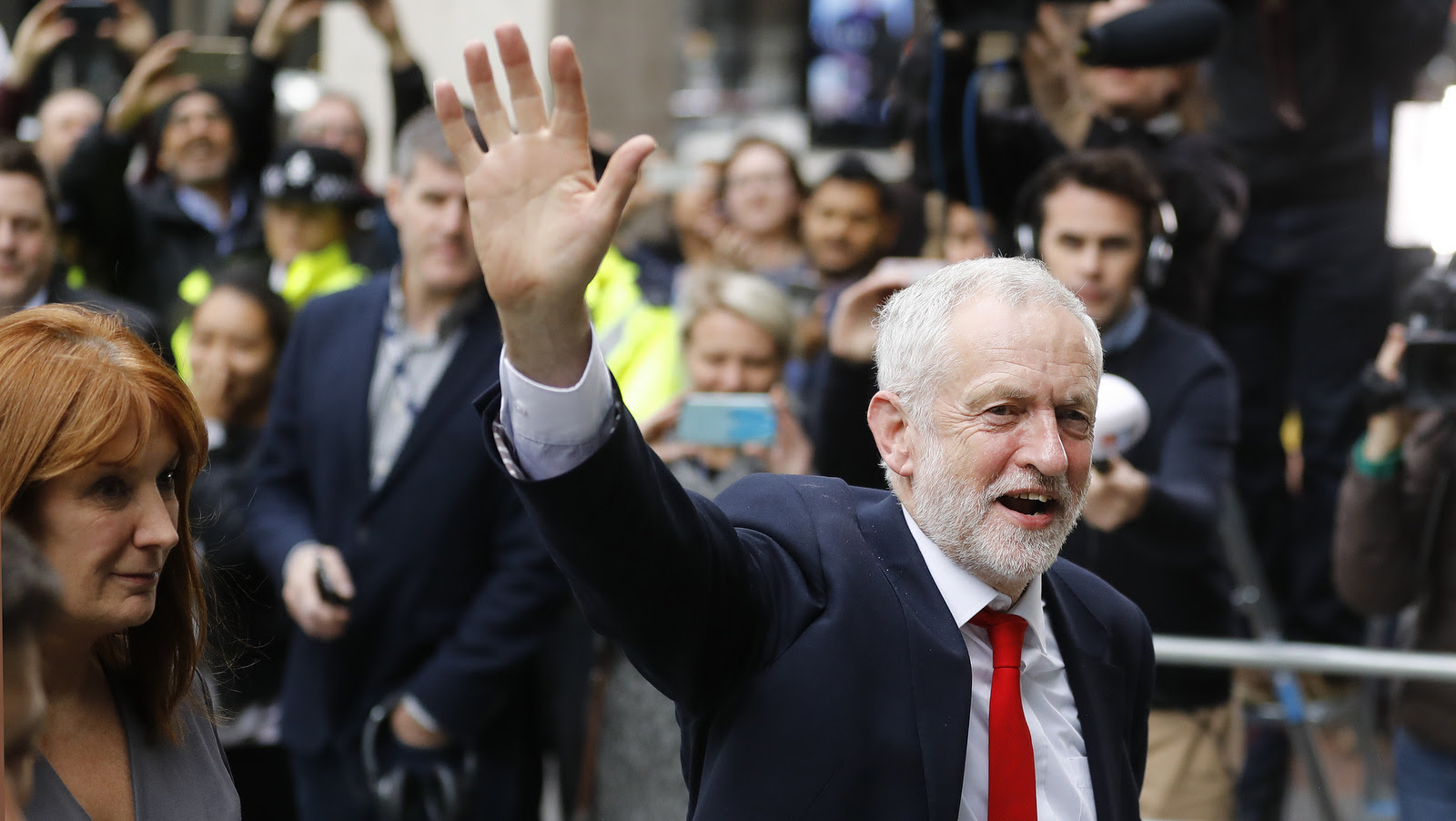 Britain's Labour party leader Jeremy Corbyn waves as he arrives at Labour party headquarters in London, Friday, June 9, 2017. British Prime Minister Theresa May's gamble in calling an early election backfired spectacularly, as her Conservative Party lost its majority in Parliament and pressure mounted on her Friday to resign. (AP/Frank Augstein)