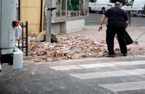 CLEAN UP: Melilla resident survey's earthquake damage