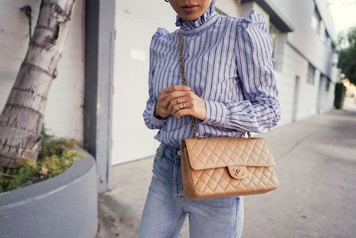 Le Fashion Blog Aimee Song Detail Shot Light Blue Striped Ruffle Neck Blouse Tan Chanel Bag Light Wash Jeans Via Songofstyle