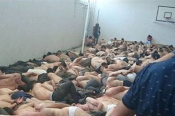 Turkey coup: Disturbing picture shows soldiers 'bound naked in courthouse' as Turkish President is warned over 'purges'