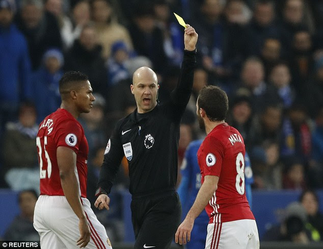 The Spaniard (right) was show a yellow card by referee Anthony Taylor (centre)