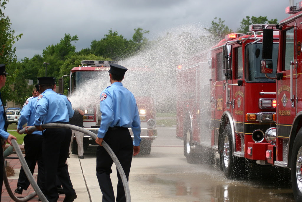 Fire Department dedicates new engine and heavy rescue with ceremonial wet-down