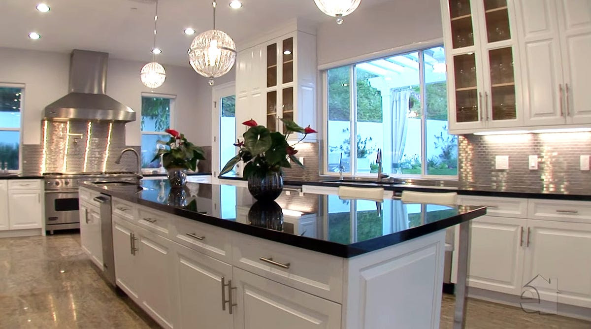 The entire kitchen is lined with granite countertops.