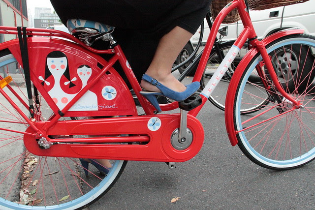 blue shoes, red bike