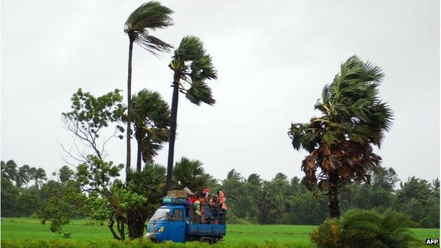 Indian villagers seeking shelter from Cyclone Phailin, 12 October 2013
