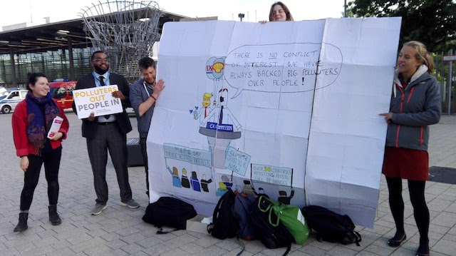 Civil society campaigners protest big polluters at the negotiating table in Bonn. Credit: Friday Phiri