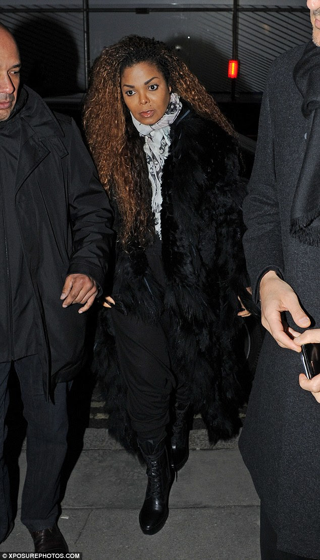 Bundled up: The 49-year-old pop star was bundled up in a furry black coat with a light patterned scarf wrapped snugly around her throat
