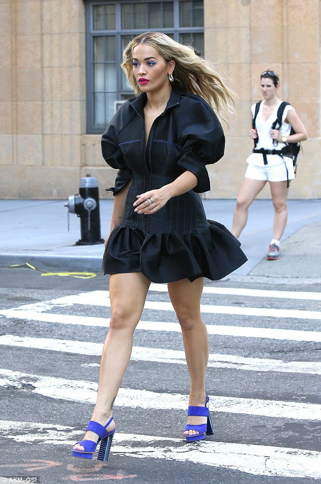 Fierce: The plunging black ruffle hemmed dress also featured billowing three-quarter length sleeves