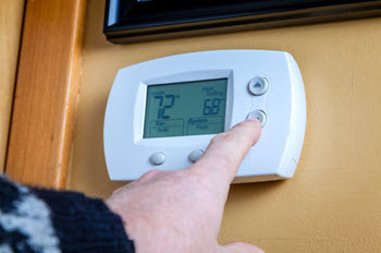 lowering thermostat for energy efficiency