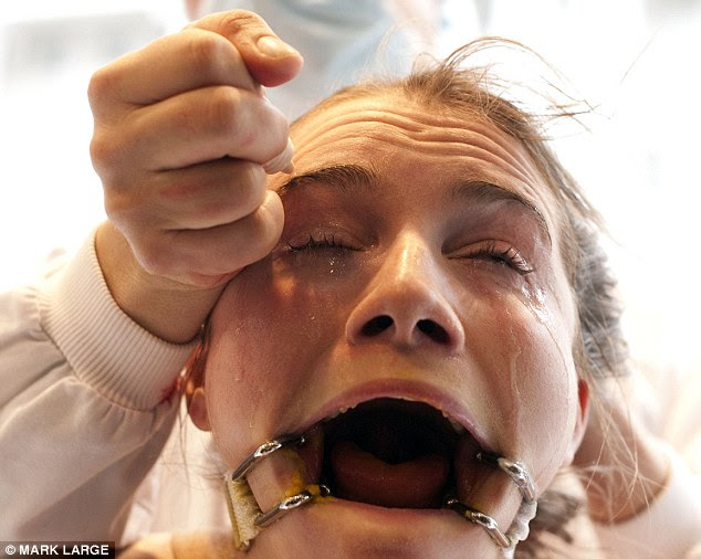 Horrific treatment: The 24-year-old re-enacts a procedure where cosmetics are dropped into an animal's eyes