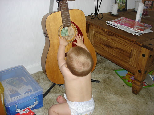 Oliver introduces himself to Daddy's guitar