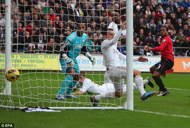 Head boy: Patrice Evra watches his header go in the back of the net