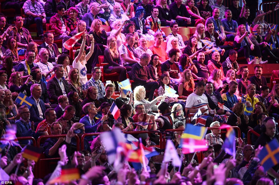 Packed-out stadium: Members of the audience warmed up for the Grand Final of the 61st annual Eurovision Song Contest